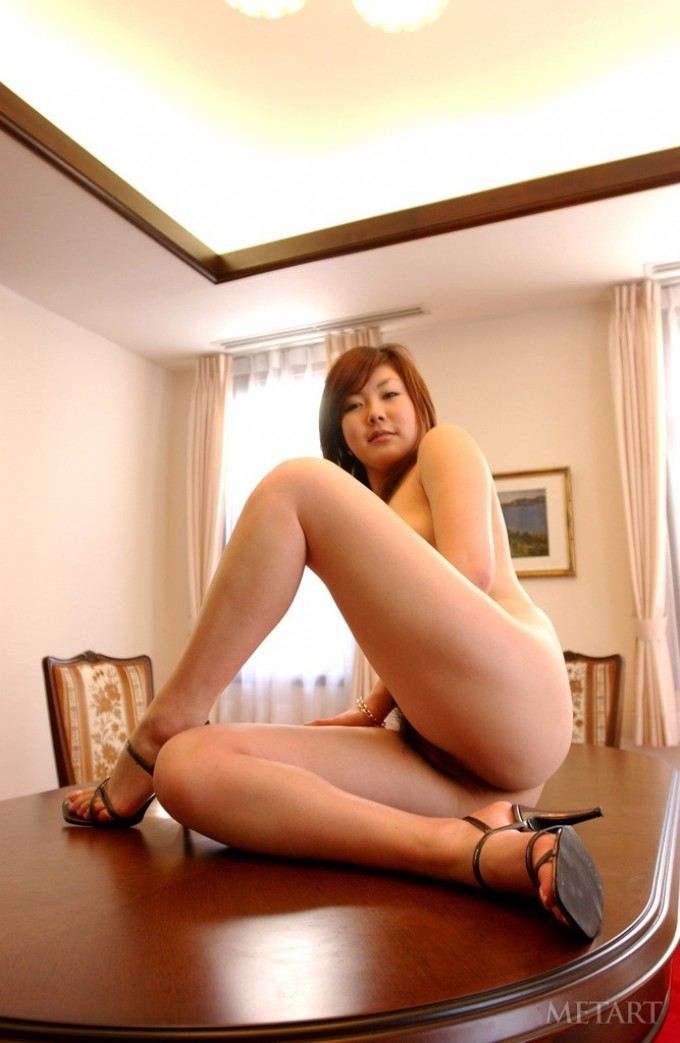 Beautiful Asian in silver high heels