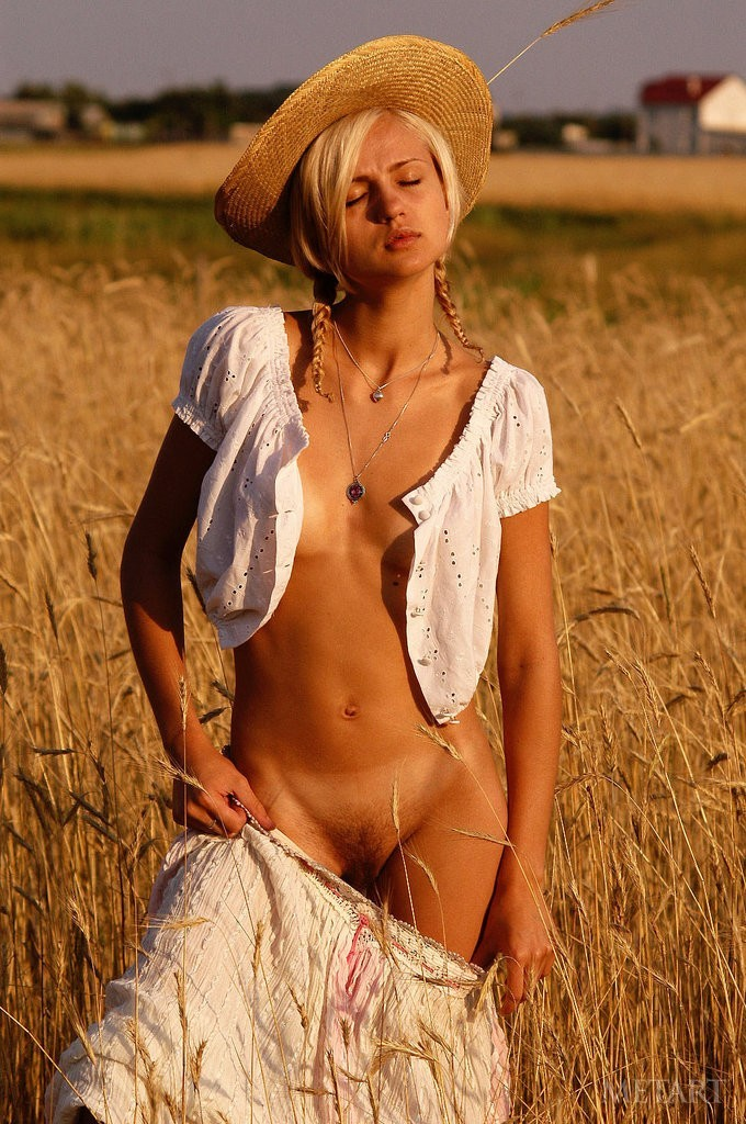 Gorgeous blonde posing on a field
