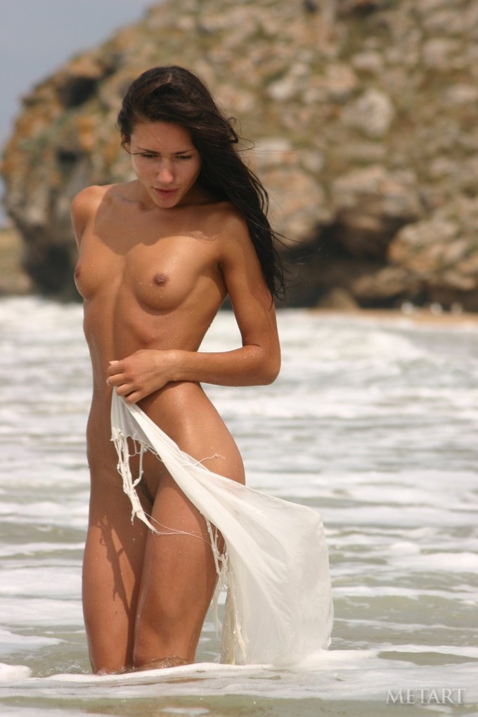Amazingly fit girl in the ocean water