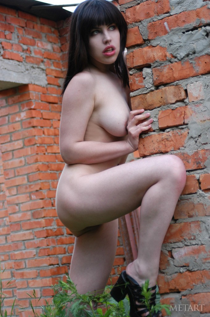 Busty brunette in a hot posing session