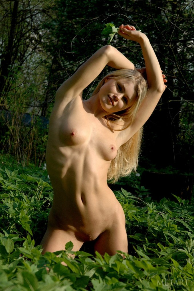 Blonde beauty showing her body outdoor