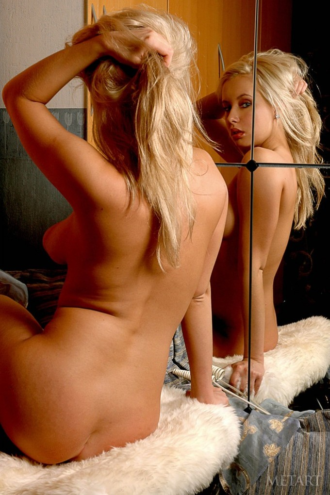 Blonde with puffy nipples plays in front of a mirror