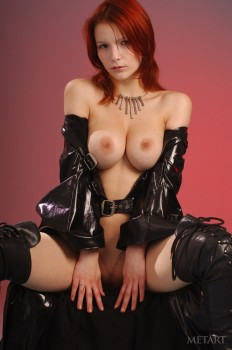Sexy redhead in black latex boots