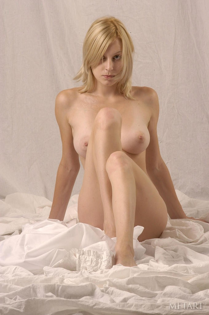 Petite blonde with a trimmed pussy