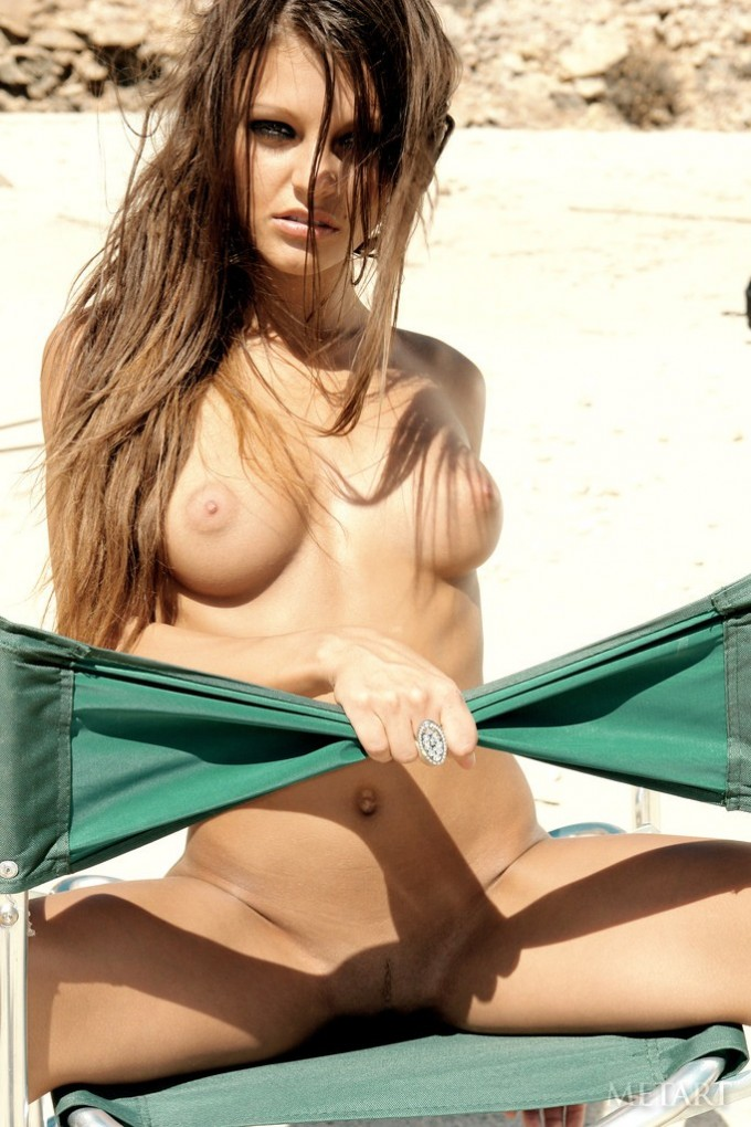 Charming mistress enjoying the scorching sun while bare