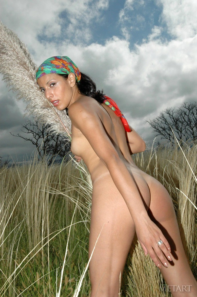 Dark-haired babe in an empty field