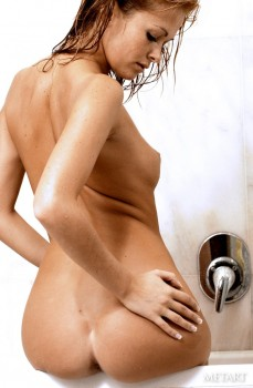 Adorable mom happily enjoying a long hot sensual shower