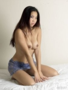 Asian brunette with perfect forms