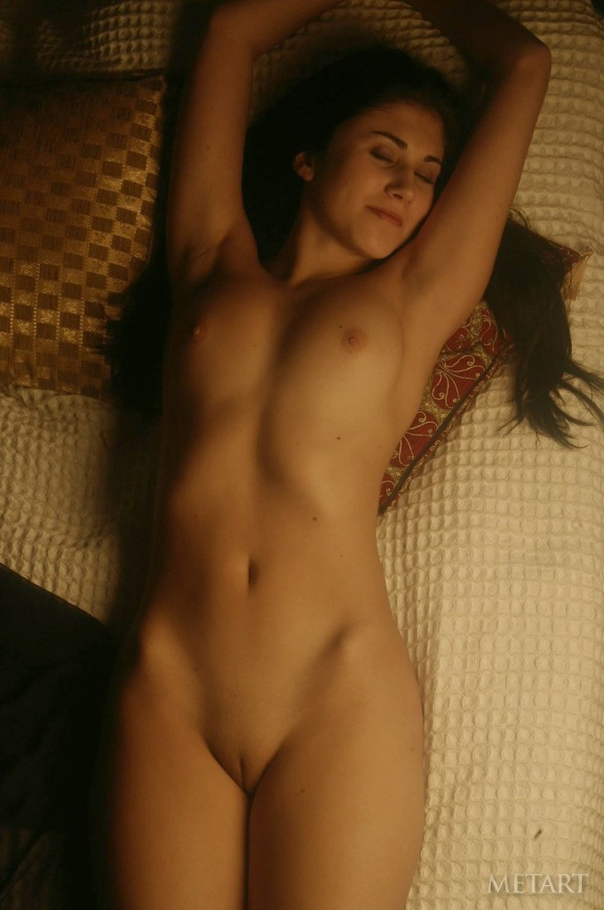 Brunette beauty revealing her boobies