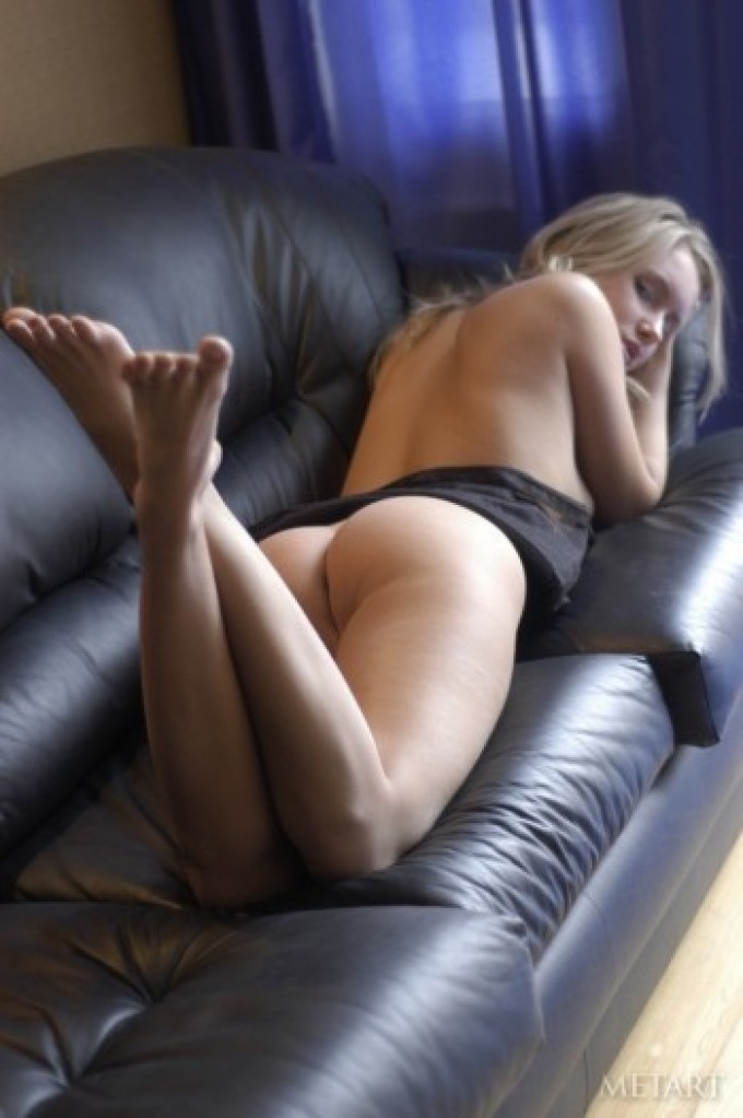 Slender blonde and her leather couch