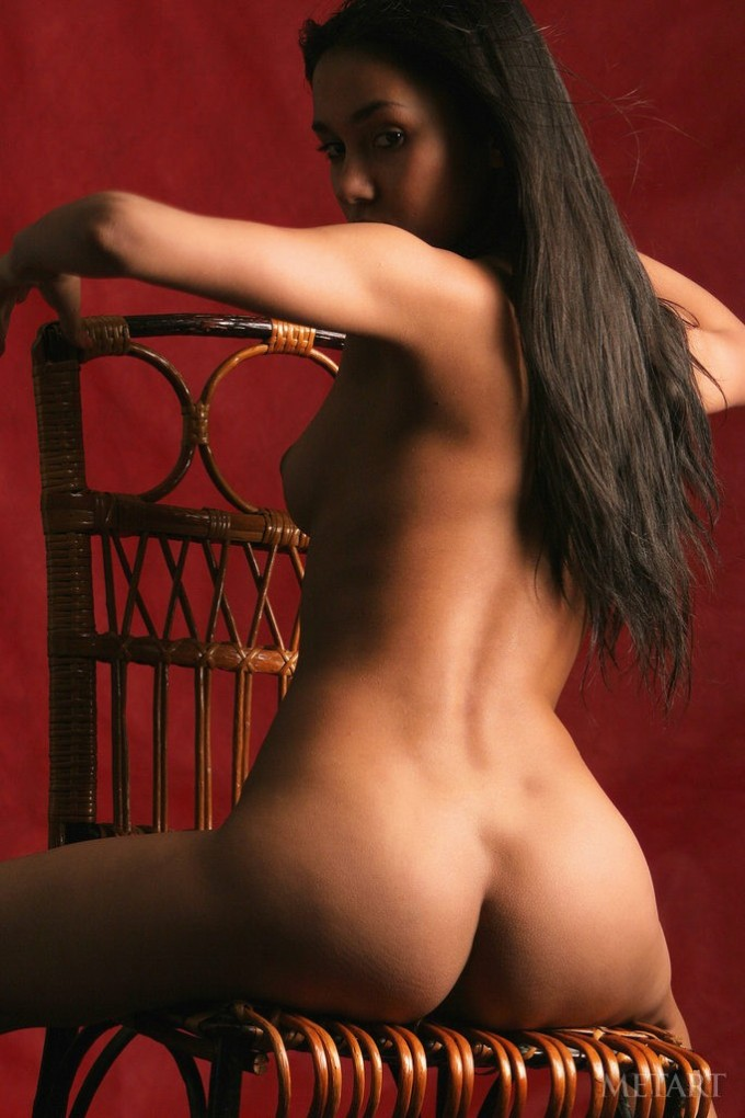 Dark-haired model and a wooden chair