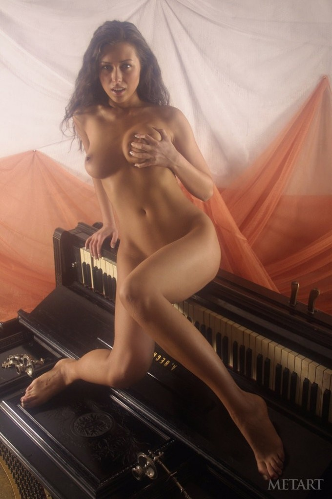 Sexy posing action with a piano