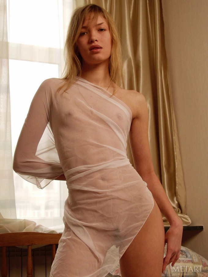 Blonde cutie in a transparent blanket