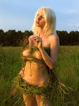 Nude posing in the wild fields