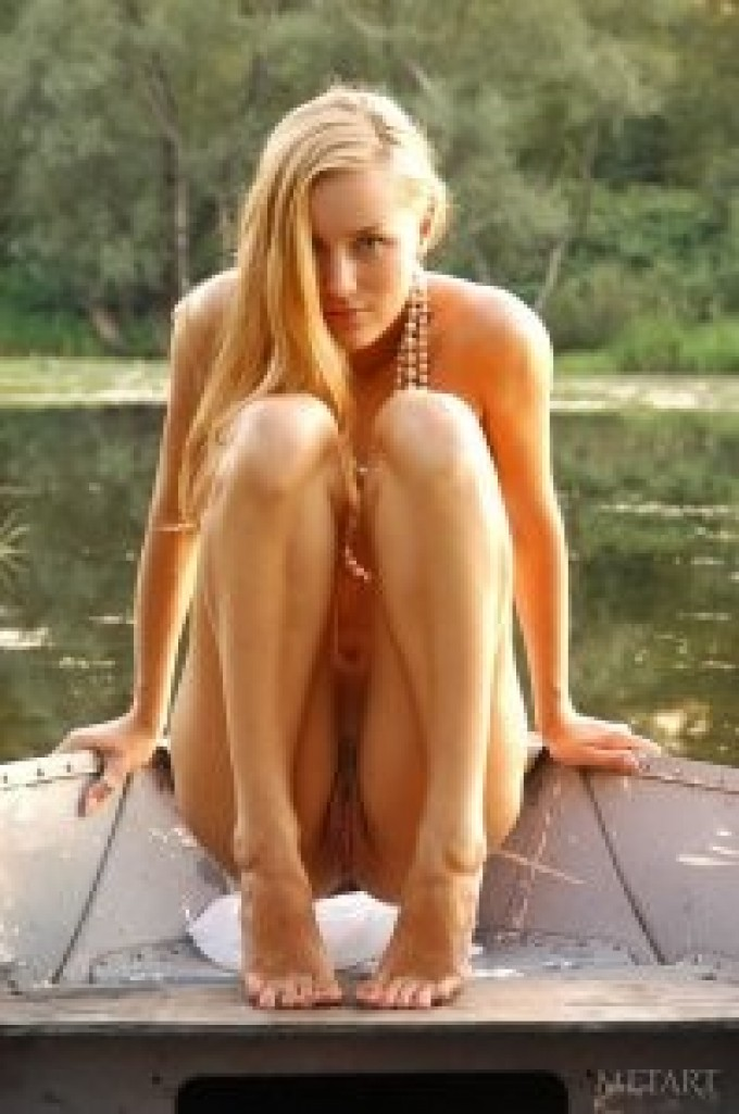 Slender young blonde on her boat