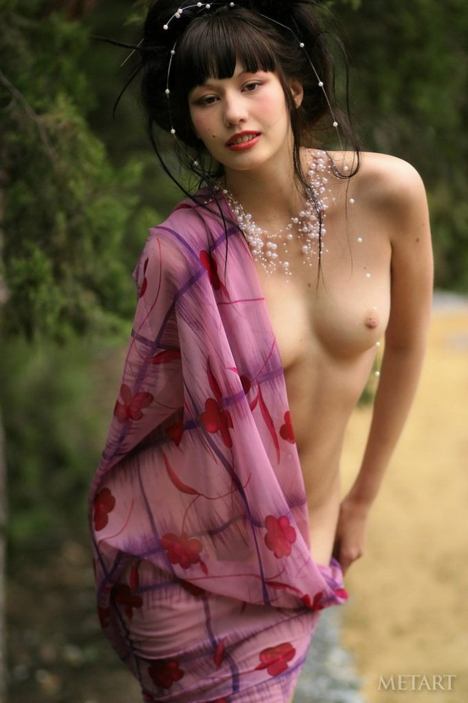 Marvelous Asian posing in a beautiful garden