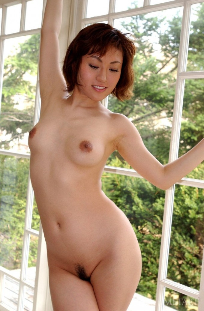 Hairy pussy of a busty Asian beauty