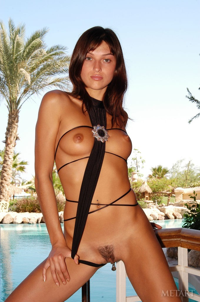 Brunette posing at the pool side