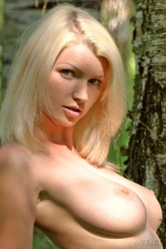 Blonde posing naked in the woods