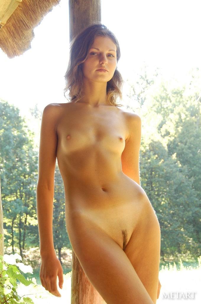 Brunette girl posing naked outdoor