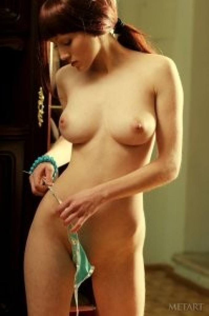 Incredible redhead getting ready for the sauna