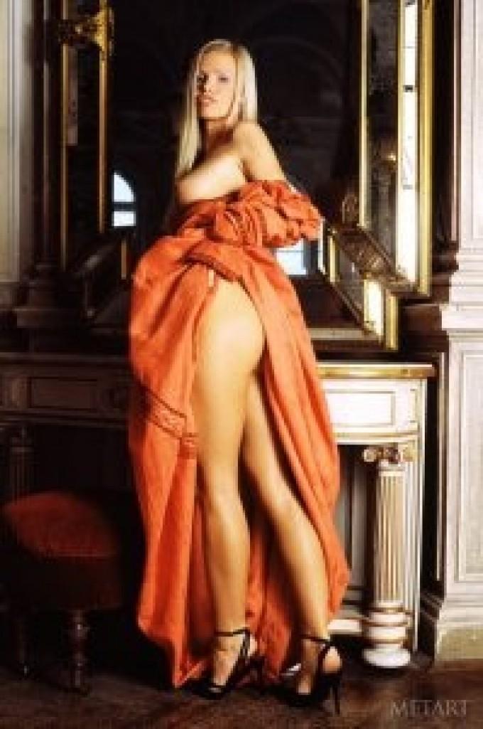 Sexy blondie undressing her sweet dress