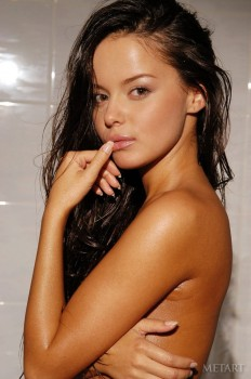 Dark haired cutie in the shower