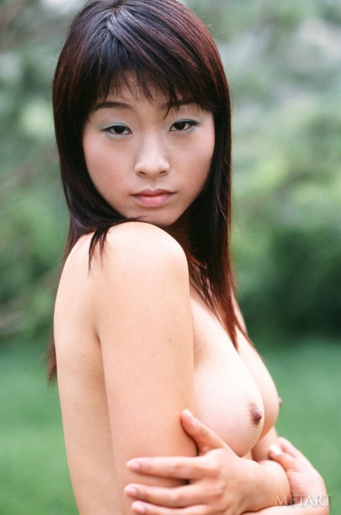Slim Asian shows off her tight buns