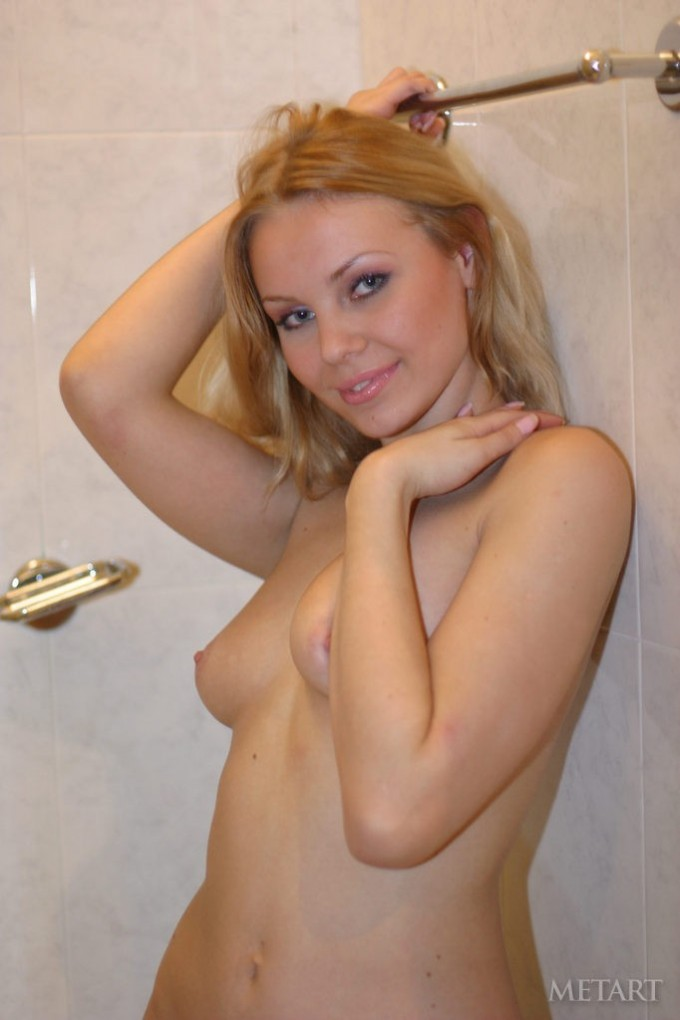 Beautiful blonde taking a shower