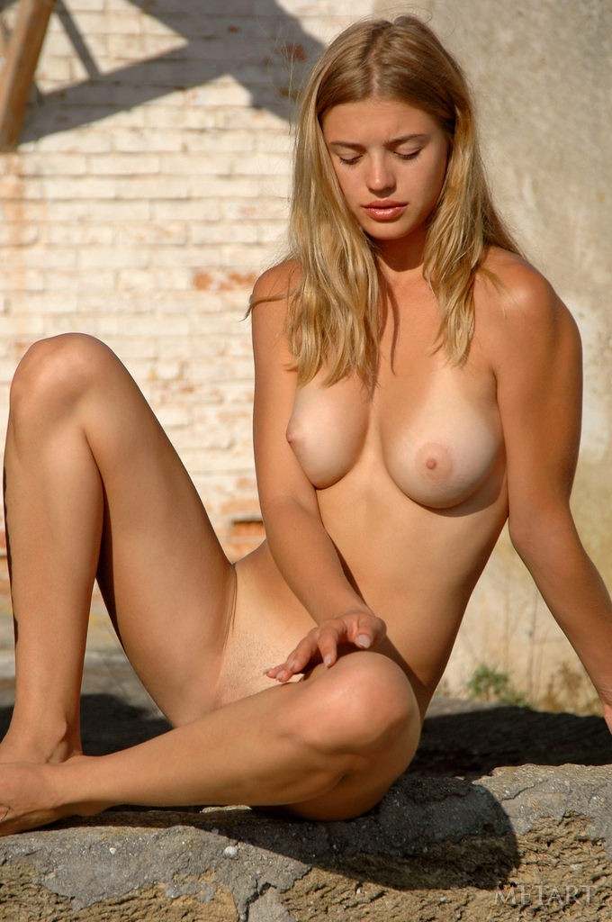 Blonde girl in a solo posing scene