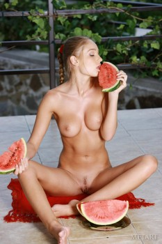 A busty woman puts some melons on her melons