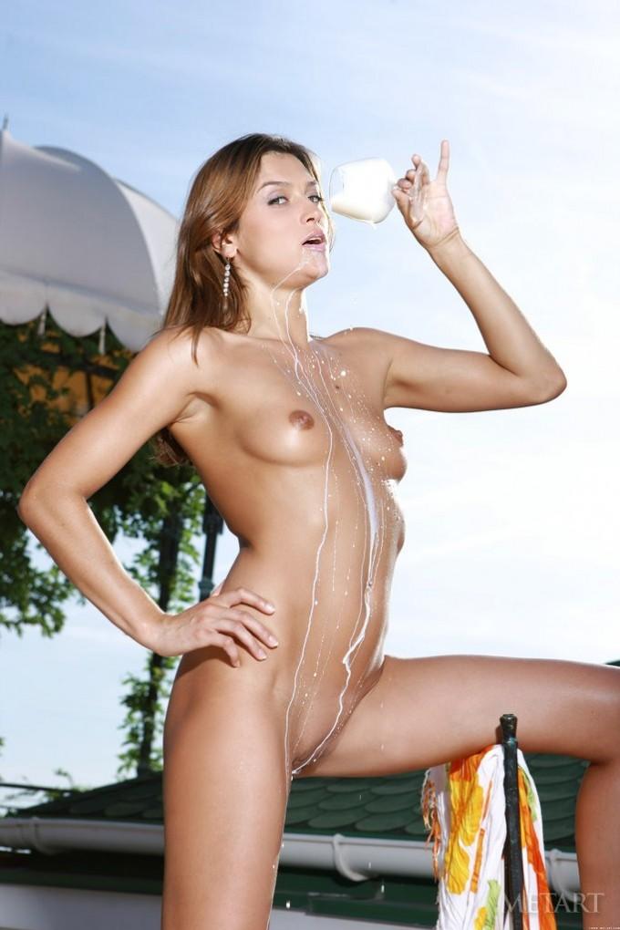 Brunette spills some milk over her body