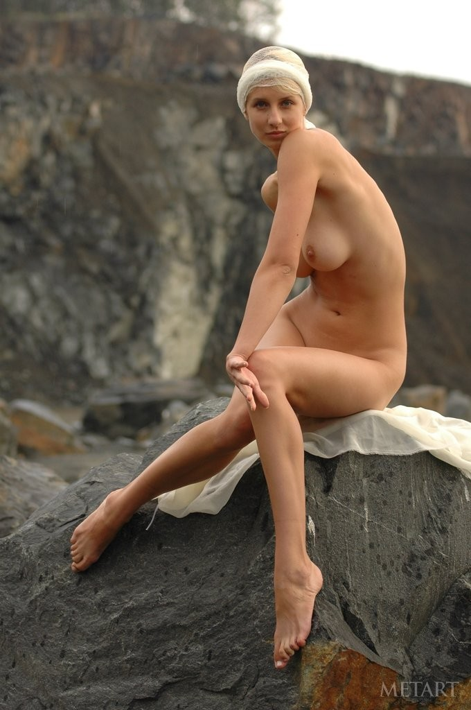 Young women dances in nature naked
