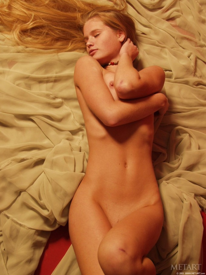 Stunning blonde is on the bed sheets