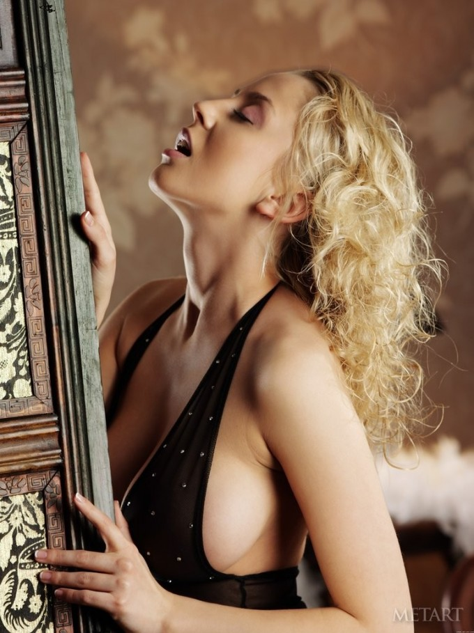 A blonde caresses her intimate areas