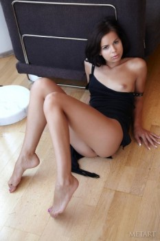 Brunette enjoys her naked body on the floor.