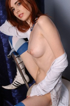 18 year old redhead is revealing her body