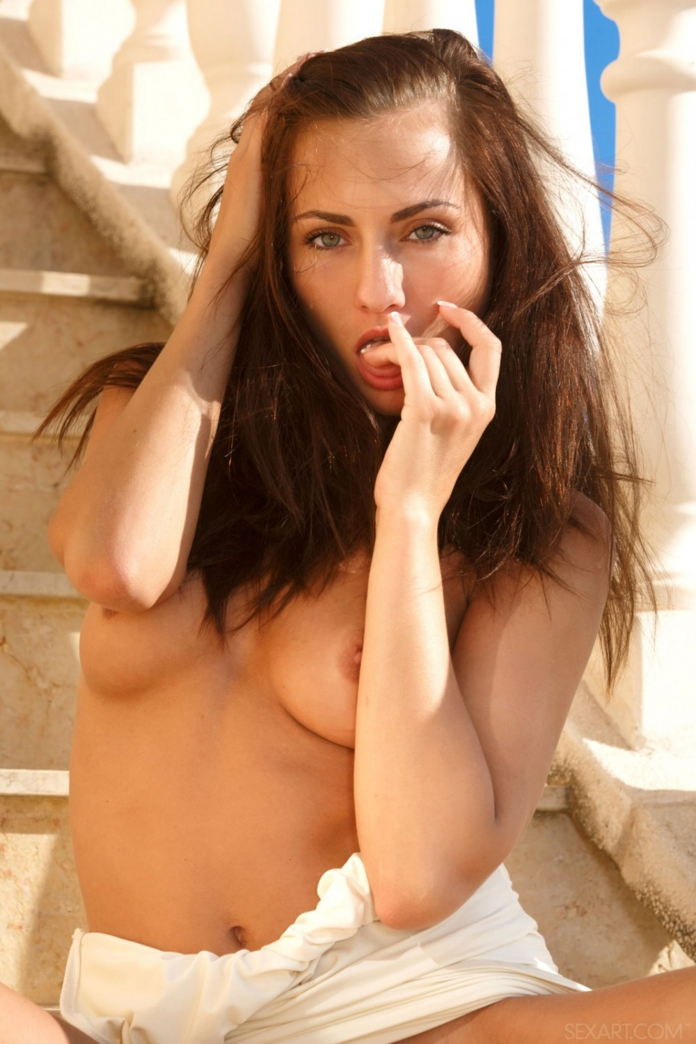 Hot girl walks down the stairs naked
