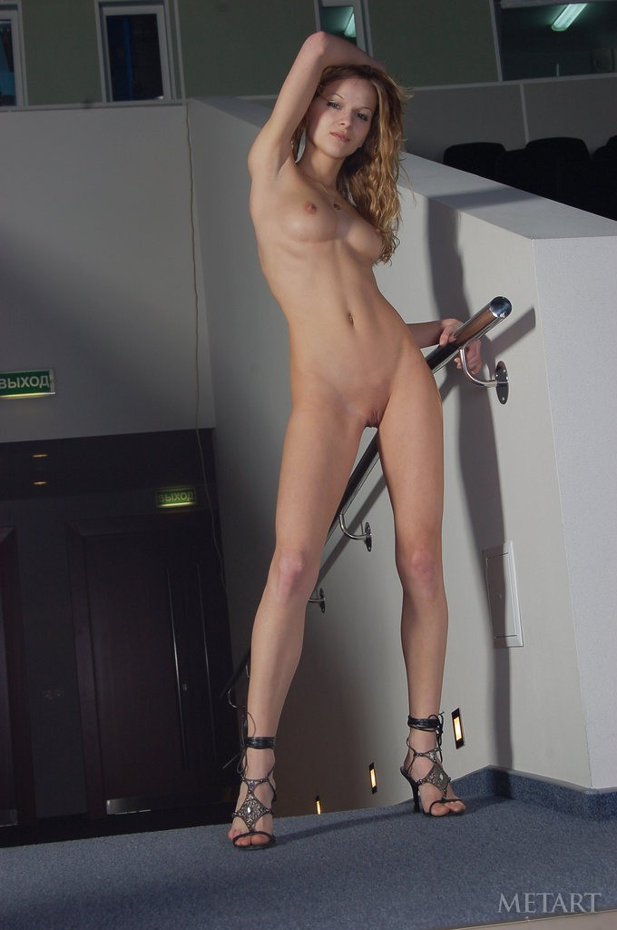 Curly blonde is making some very sexy poses
