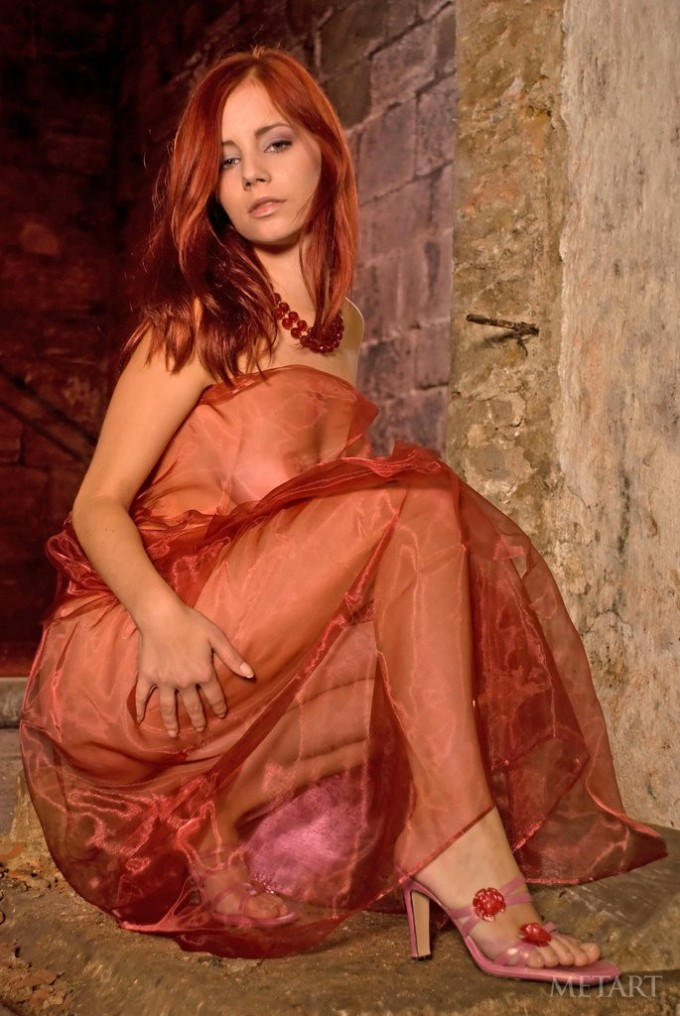 Formidable redhead in a stunning dress