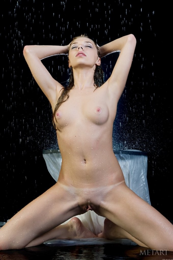 Wet pussy is displayed on some water