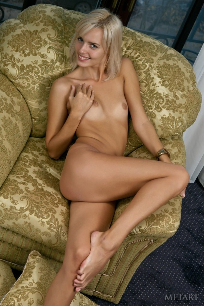 Blonde cutie shows off her sexy and very thin body