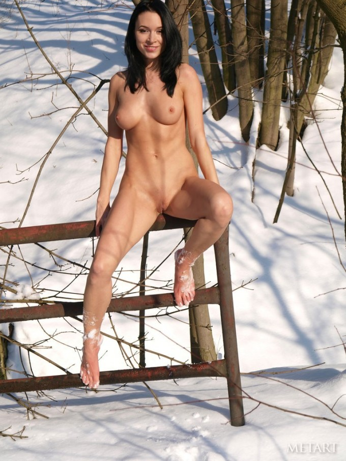 Jovial female strips outdoor during winter to pose