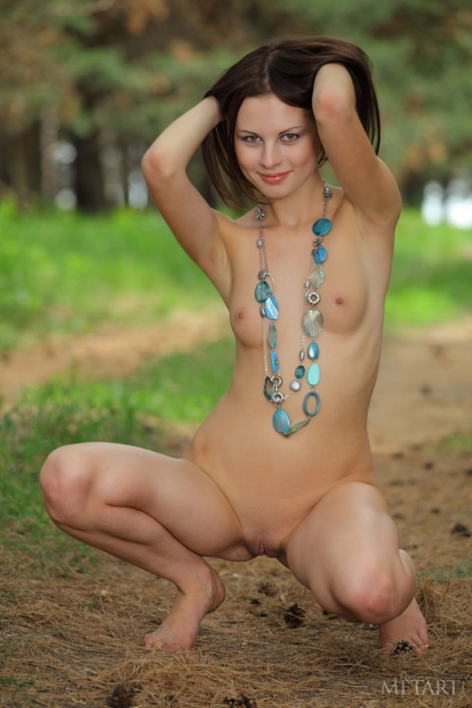 Cute brunette posing nude in the forest