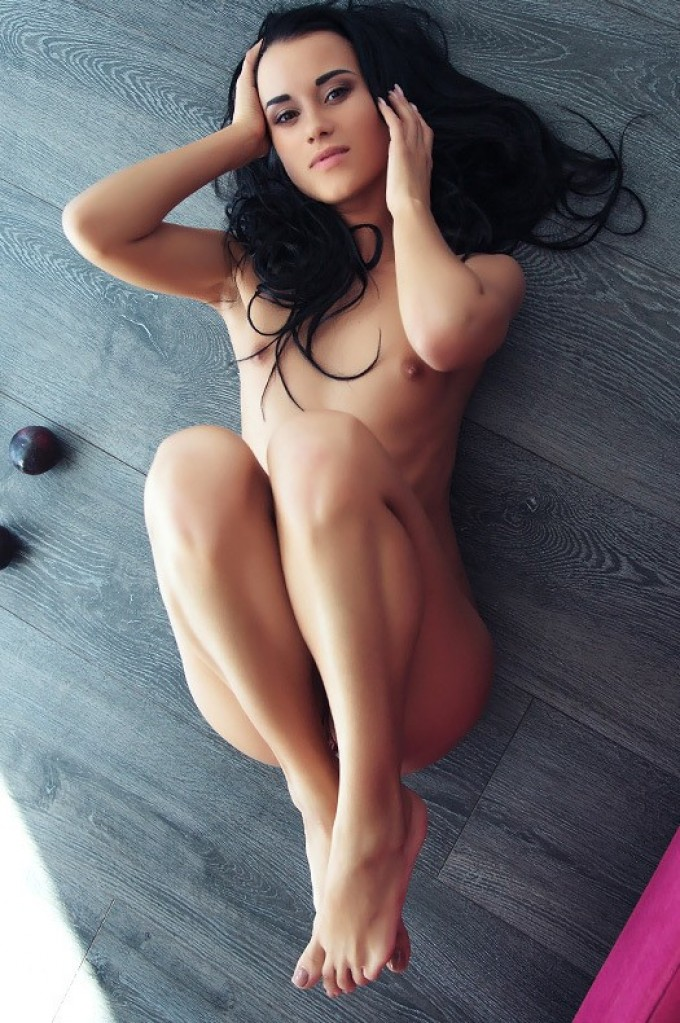 Petite chick is displaying her naked flesh