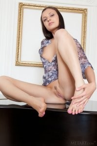 Sweetie stripteases on the piano.