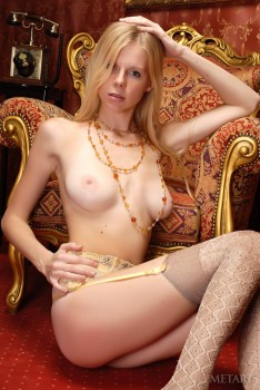 Glam chick in stockings teases pussy in a posh armchair