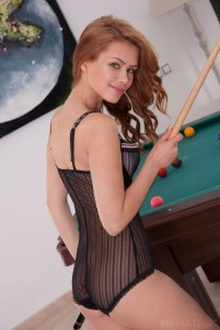 Naked babe plays pool on the table