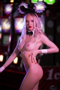 Half-naked Playboy bunny goes to casino