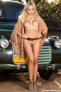 Burning hot blonde poses nude by retro truck and bus